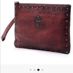 Dark red leather clutch bag
